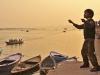 A boy flying his kite at the Ghats of Varanasi